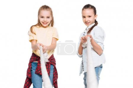 Two girls play tug of war