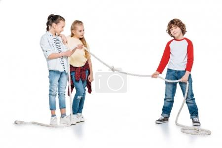 Photo for Children play tug of war, boy vs girls, kids sport isolated concept - Royalty Free Image