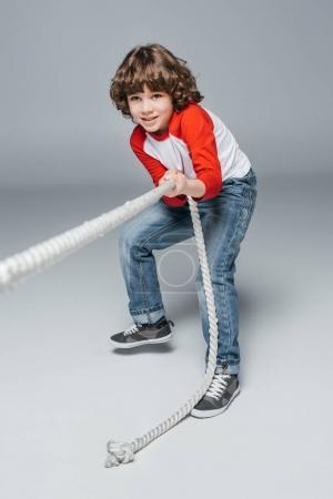 Cute boy play tug of war