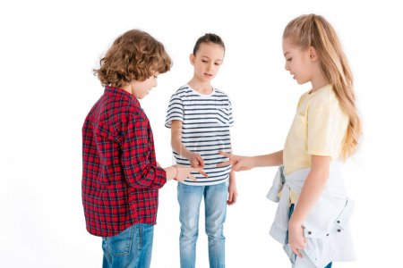 Photo for Children playing in rock-paper-scissors game isolated on white - Royalty Free Image
