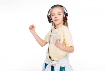 Kid in headphone listening music