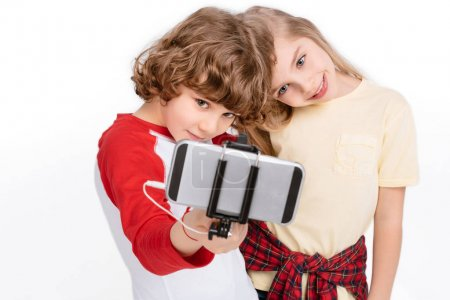 Kids taking selfie with smartphone