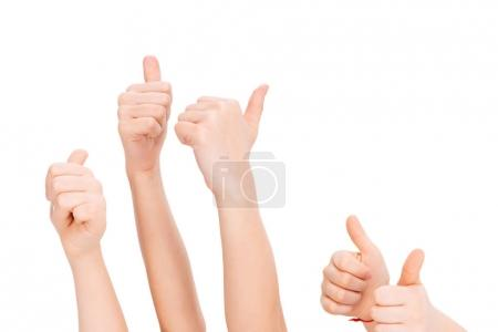 Photo for Kids gesturing thumbs up isolated on white - Royalty Free Image