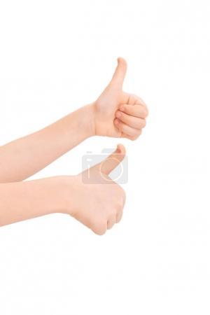 Foto de Niños gesticular pulgares arriba aisladas en blanco - Imagen libre de derechos