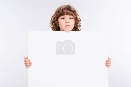 Boy holding white blank board