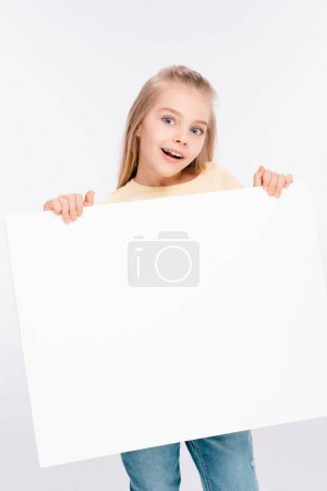 Photo for Cute blond girl holding white blank board in hands isolated on white - Royalty Free Image
