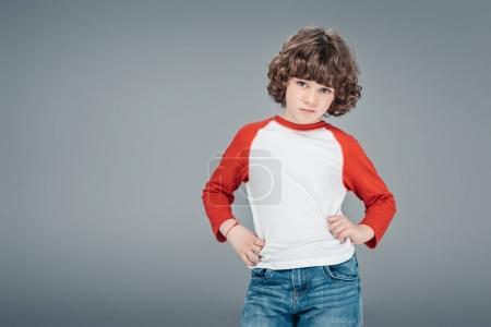 Curly little boy posing