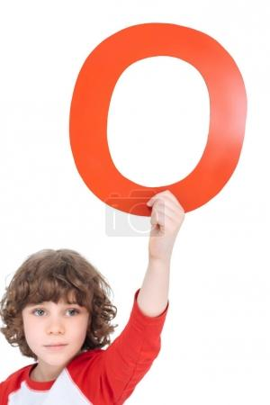 Photo for Cute boy holding red alphabet letter over head isolated, alphabet letters concept - Royalty Free Image
