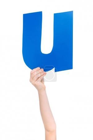 Alphabet letter in child hand