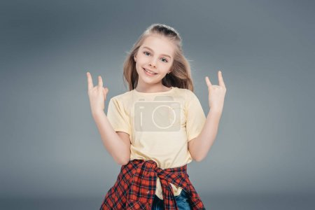 Girl gesturing rock sign