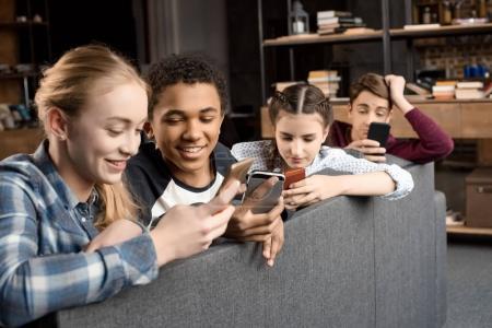 teenagers using smartphones