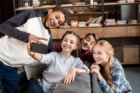 teenagers taking selfie on smartphone