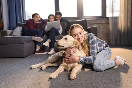 Teenagers and golden retriever dog