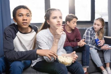 Teenagers eating popcorn