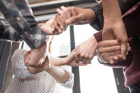 Teenagers gesturing together