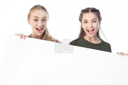 teenage girls with banner