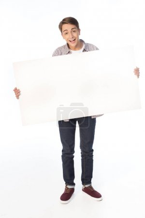 teenage boy holding banner