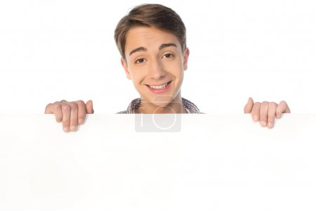 teenage boy holding banner