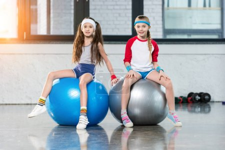 little girls in sportswear at fitness studio