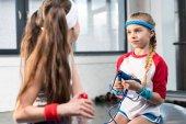 little girls in sportswear at fitness studio