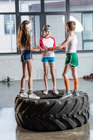 kids in sportswear playing at fitness studio