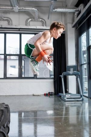 kid boy jumping at fitness studio