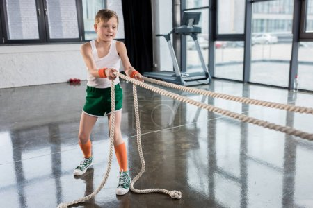 kid boy training with ropes