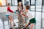 kids training with ropes at fitness studio