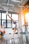 kids in sportswear training at fitness studio