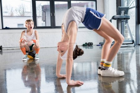 kids in sportswear training at fitness studio
