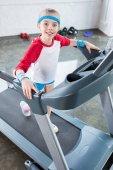 kid girl training on treadmill