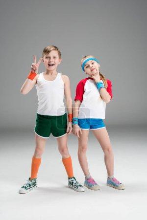 Boy and girl in sportswear