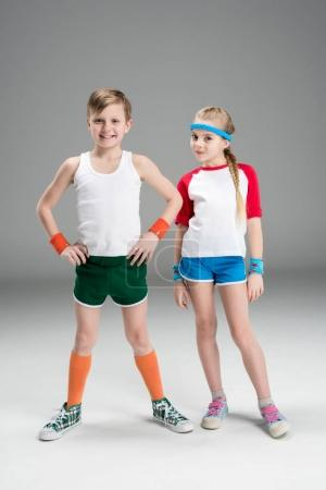 Boy and girl in sportswear