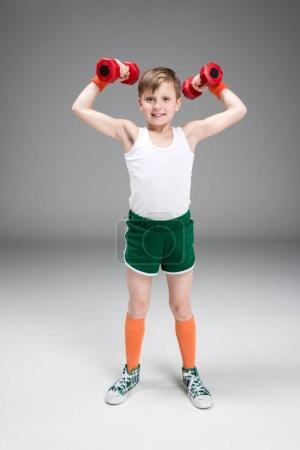 active boy with dumbbells