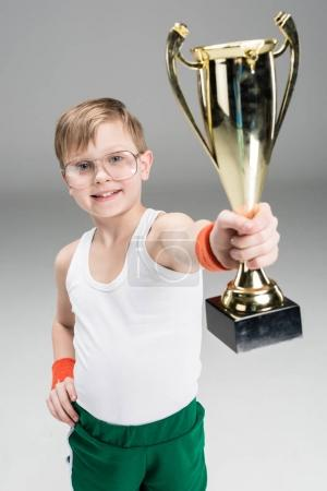 Active boy with champion's goblet