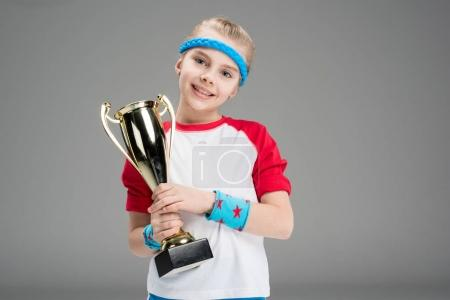 active girl with champion's goblet