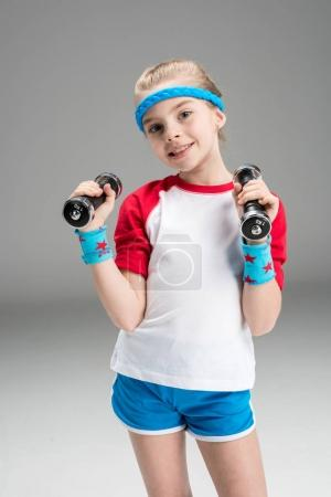 active girl with dumbbells
