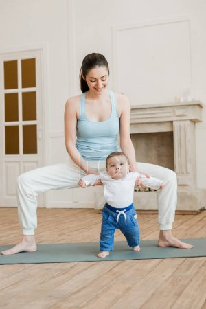 Mother with baby boy practicing yoga