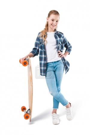 Photo for Happy girl posing with skateboard isolated on white in studio - Royalty Free Image