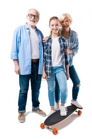 family posing with skateboard