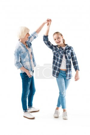 grandchild dancing with grandmother