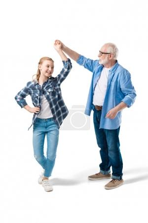 grandchild dancing with grandfather