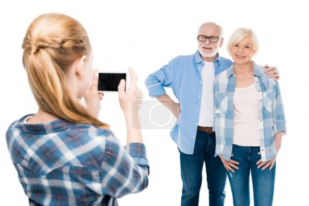 granddaughter taking photo of grandparents