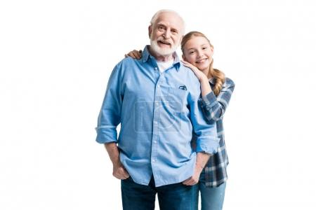 Photo for Happy grandfather and granddaughter hugging isolated on white in studio - Royalty Free Image