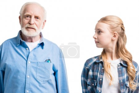 grandfather and granddaughter posing