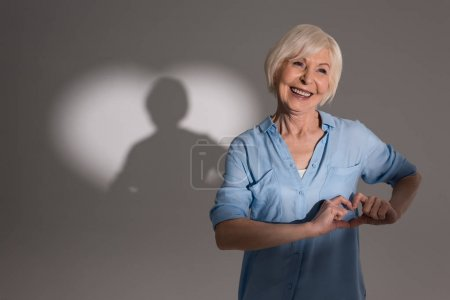 Woman with heart shaped shadow