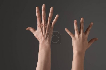 Photo for Cropped view of human hands up isolated on grey, young and senior people concept - Royalty Free Image