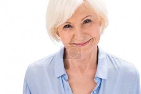 Photo for Portrait of happy senior woman looking at camera isolated on white in studio - Royalty Free Image