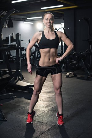 fit woman posing at gym