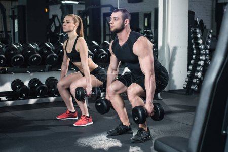 couple exercising with dumbbells